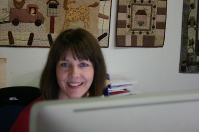Lyn at her computer