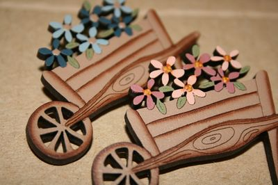 Wheelbarrow brooches