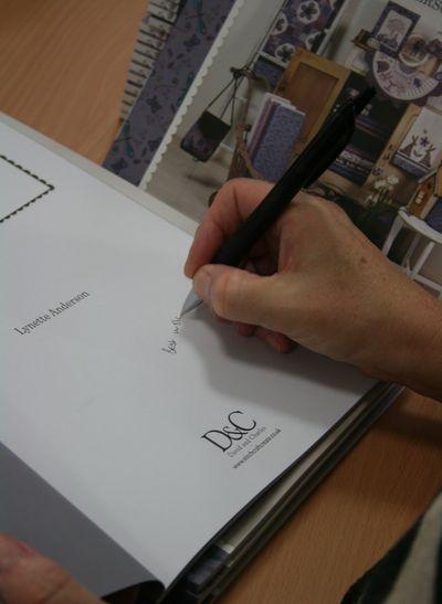 Lynette signing books